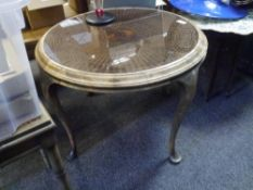 A 1930's cane inset walnut circular coffee table