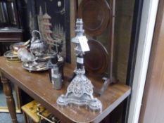 A white metal table lamp, possibly originally the base of an oil lamp