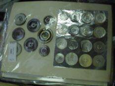 Twelve sheets of shell, glass and plastic vintage buttons