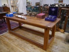 A pitch pine refectory table. 75cm by 200cm by 80cm