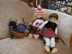A Scottish porcelain head costume doll, Kyla Kraft; together with another costume doll and three