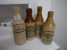 A group of four 19th/early 20th century Scottish stoneware bottles comprising Plynine Co.