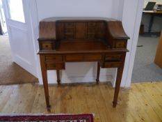 A mahogany desk in the Carlton House style, 20th century, of characteristic form. 98cm by 87cm by