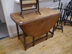 An oak gateleg dining table in 17th century style, late 19th century, with twin drop leaves on
