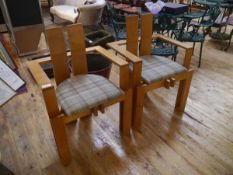 A pair of contemporary beech open armchairs influenced by the Glasgow style, with tweed plaid seats