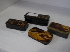 A group of four 19th century horn and tortoiseshell snuff boxes, each rectangular.