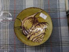 A Muriel & Gordon Macintyre Nairn pottery shallow bowl, the interior decorated with a murex shell.