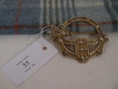 """A late 19th century Celtic Revival parcel gilt white metal """"Tara"""" brooch or plaid pin, stamped"""