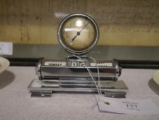 A chromium plated perpetual desk calendar mounted with a barometer, c. 1930, the barometer dial