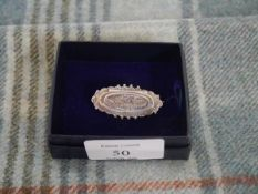 """A Victorian silver name brooch, Birmingham 1899, hinged compartment opening to """"From Jim"""""""