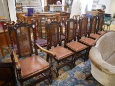 A set of six late Victorian oak dining chairs, including one carver, in 17th century style, each