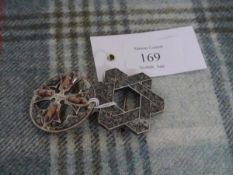 Two late 19th / early 20th century Scottish hardstone brooches, one marked for Rettie & Sons,
