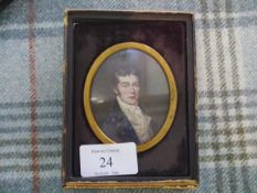 A portrait miniature of a Regency gentleman in a brass buttoned coat, oval, in a fitted leather