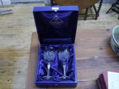 A cased pair of Edinburgh Crystal goblets, the bowls with pointed arch diamond cut panels on
