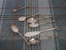 A group of silver flatware each piece with thistle terminal comprising four teaspoons, Edinburgh