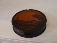"A 19th century papier mache snuff or ""sneeshin"" box, printed with a panoramic view of Edinburgh"
