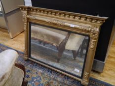 A George IV giltwood overmantel mirror, the rectangular plate within an ebonised reeded slip
