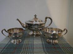 A George V Scottish silver three piece tea service, T.S. Cuthbert, Glasgow 1930, each piece