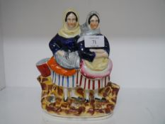 A Staffordshire figure group of two fishwives