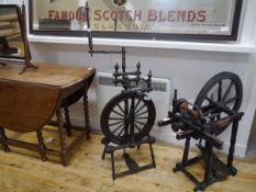 A turned wooden spinning wheel. 125cm