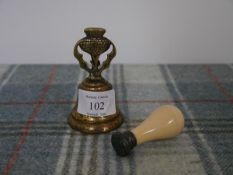 A 19th century ivory handled desk seal, with bloodstone matrix engraved with a monogram; together