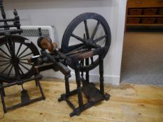 A 19th century turned wooden spinning wheel. 80cm