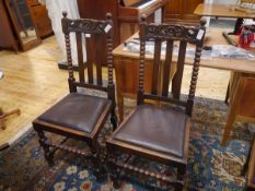 A pair of late Victorian oak side chairs, in 17th century style, each with bobbin turned uprights