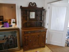 A grain painted dresser in the Art Nouveau taste, c. 1900, the mirror-inset superstructure with an