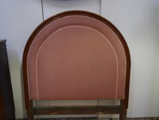 An early 20th century mahogany bed frame, the high arched headboard with padded inset. Width 147cm