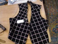 A late 19th/early 20th century boy's plaid waistcoat, applied on black velvet with needlework