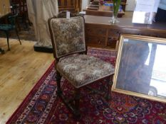 A Victorian walnut-framed side chair, raised on turned fluted legs joined by stretchers.