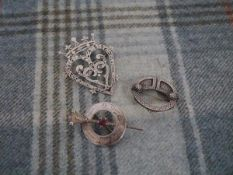A Celtic Art Industries Iona silver luckenbooth brooch;. a Ward Brothers silver brooch with