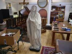 A late 19th century lifesize plaster figure of The Virgin, modelled standing with hands clasped
