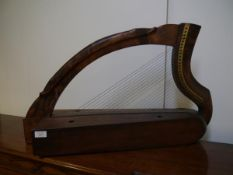A Celtic harp, the frame with moulded and incised decoration