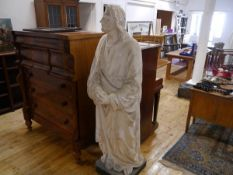 A late 19th century lifesize plaster figure of St. John and modelled standing with clasped hands and