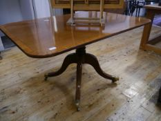 A George III mahogany breakfast table, early 19th century, the string-inlaid rectangular top with
