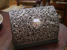An Edwardian silver-mounted stationery box, London 1909, the hinged cover and front decorated with