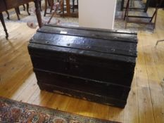 A 19th century painted metal-bound dome-top trunk. 53cm by 76cm by 46cm