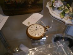A 19th century gold-plated open face pocket watch, the white enamel dial signed Regina, with Roman