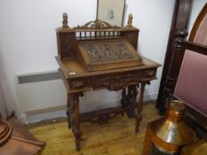 A 19th century Renaissance Revival oak writing table, the superstructure with carved lion surmounts,