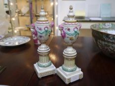 A pair of late 19th century Continental porcelain cassoulets, each metamorphic candleholder/urn on