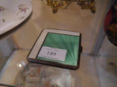 A George V silver and enamel cigarette case in the Art Deco taste, Birmingham 1933, the cover with a