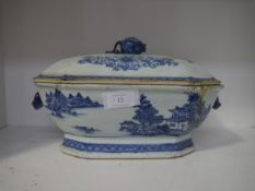 A Chinese Export blue and white porcelain tureen, c. 1800, of shaped octagonal form, the domed cover