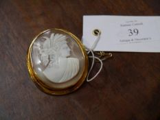 A shell cameo brooch, late 19th century, the oval cameo carved with a female Classical bust, mounted