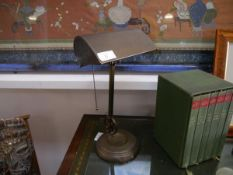 A mid-20th century patinated metal adjustable desk lamp, with integral metal shade, articulated
