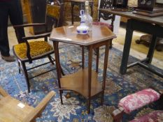 An early 20th century inlaid mahogany occasional table, the hexagonal crossbanded top centred by