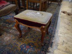 A 19th century walnut stool, the rectangular needlework seat on cabriole legs terminating in