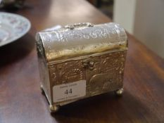 A small Dutch silver casket, London import marks for 1902, with domed cover and ball feet, stamped