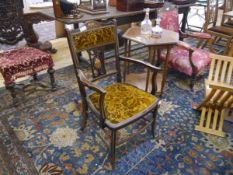 An Edwardian inlaid rosewood open armchair, decorated with floral sprays