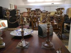 A pair of 19th century silver plate on copper five light candelabra, each baluster nozzle with